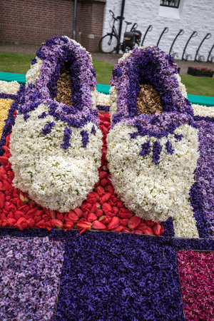 Noordwijkerhout, Netherlands - April 21,  2017: Traditional clogs made of hyacinths at the traditional flowers parade Bloemencorso from Noordwijk to Haarlem in the Netherlands