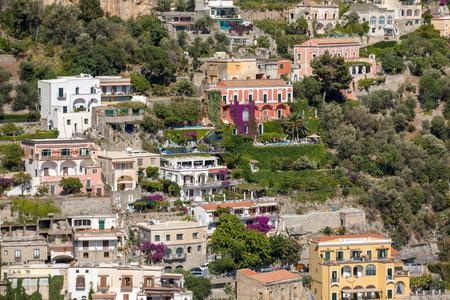 Positano, Italy - June 12, 2017: Small town of Positano along Amalfi coast with its many wonderful colors and terraced houses, Campania, Italy.