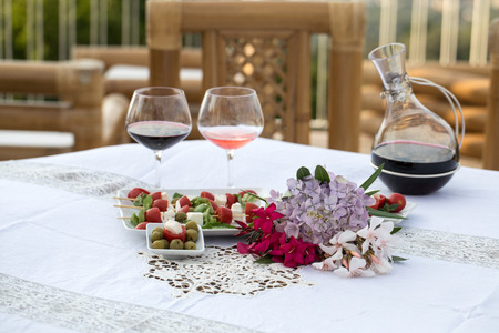 Table on the terrace prepared for a romantic dinner