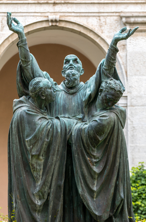 Monte Cassino, Italy - June 17, 2017: The entrance cloister of Monte Cassino Abbey and the death of Saint Benedict Statue. Italy Éditoriale
