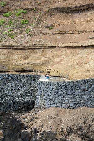 Cliff along the promenade in Porto da Cruz on Madeira. Portugal