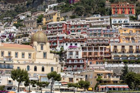 Positano, Italy - June 13, 2017: Small town of Positano along Amalfi coast with its many wonderful colors and terraced houses, Campania, Italy.