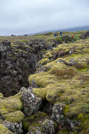 Thingvellir, Iceland - July 19, 2017: People walking in a Fault Line, Thingvellir National Park, Iceland  Editorial