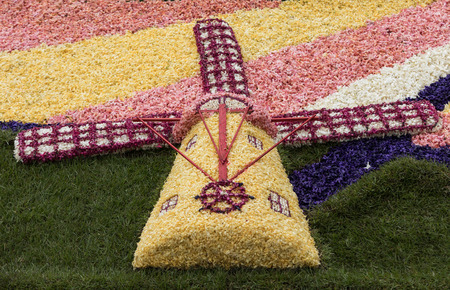 Noordwijkerhout, Netherlands - April 23,  2017: Traditional windmill made of hyacinths at the traditional flowers parade Bloemencorso from Noordwijk to Haarlem in the Netherlands