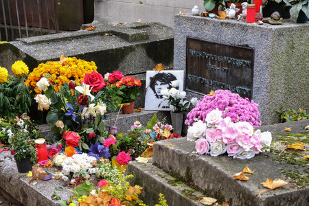 Paris, France - September 2017: Jim Morrison grave in Pere-Lachaise cemetery, Paris. Each year thousands fans and curious visitors come to pay homage to Jim Morrisons grave