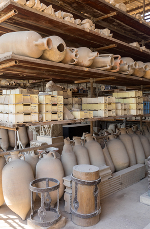 Vessels, pots and a variety of artifacts surviving eruption of Vesuvius in Pompeii  have been excavated and catalogued .Pompei, Italy