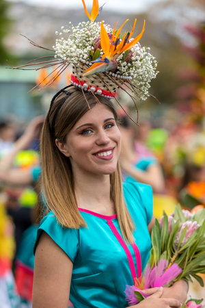 Funchal; Madeira; Portugal - April 22; 2018: Annual parade of the Madeira Flower Festival in the city of Funchal on the Island of Madeira. Portugal. Foto de archivo - 100570893