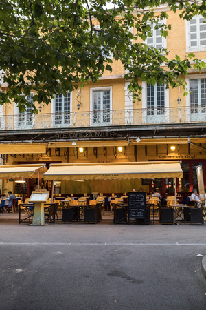 Arles, France - June 26, 2017: Cafe Van Gogh at Place du Forum in Arles. Provence, France. This is the same Cafe Terrace that Vincent van Gogh painted in 1888 and is now a landmark tourist attraction.