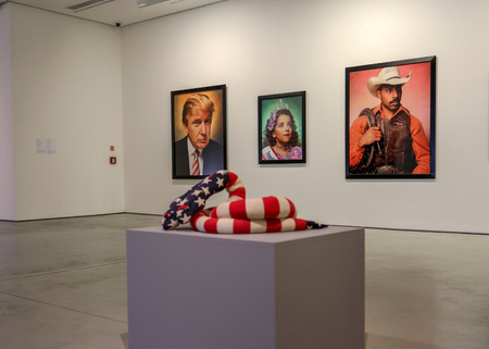 Cracow, Poland - May 8, 2018: Exibition Motherland in Art at Mocak in Krakow. Melissa Vanderberg - Polycephalic Patriot. Two-headed plush snake, made from pieces of flags is a criticism of a two party politicial system