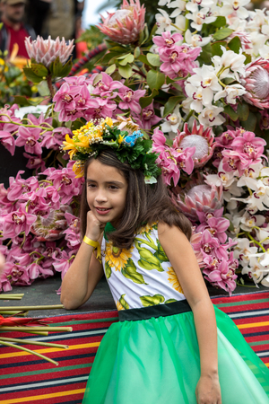 Funchal; Madeira; Portugal - April 22; 2018: The last moments before the parade, girl in a colorful dress at the Madeira Flower Festival , Funchal, Madeira, Portugal