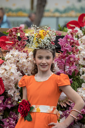 Funchal; Madeira; Portugal - April 22; 2018: The last moments before the parade, girl in a orange dress at the Madeira Flower Festival , Funchal, Madeira, Portugal Foto de archivo - 101833537