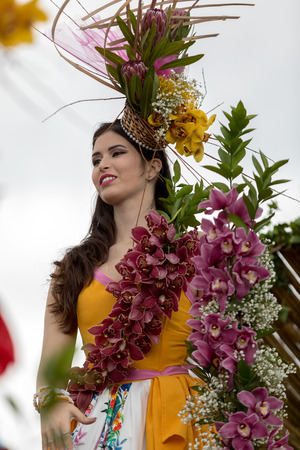 Funchal; Madeira; Portugal - April 22; 2018: Woman in a colorful costume at the Madeira Flower Festival Parade , Funchal, Madeira, Portugal Foto de archivo - 103491949