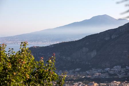 The majestic Vesuvius envelops the morning mist. Sorrento, Italy
