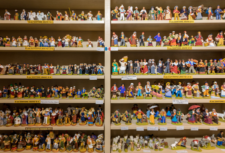 Les Baux de Provence, France - June 26, 2017: Miniature figurines of people in costumes from ancient times in a shop in Les Baux de Provence. France