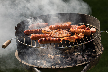 Unhealthy but tasty grilled sausages and meat Stock Photo
