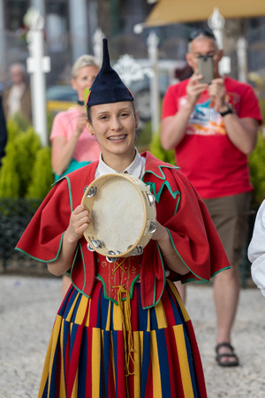 Funchal, Portugal - April 19, 2018: Folk musicians and dancers performing on the Avenida Arriaga in Funchal on the Madeira Island, Portugal.
