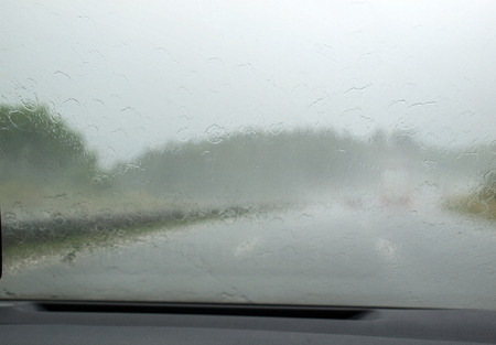 Downpour on the highway seen from inside the car