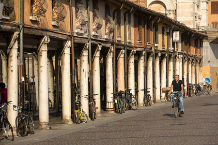 Ferrara, Italy - June 10, 2017: Loggia of the Merchants along the side of Ferrara Duomo, Piazza Trento Trieste, Ferrara, Emilia-Romagna, Italy, Europe. Editorial