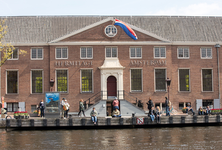 AMSTERDAM, NETHERLANDS - APRIL 20, 2017: Tourists outside the Hermitage Amsterdam, the Netherlands Editorial