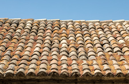 Old fashioned style roof tiles on rural building in Provence France Foto de archivo