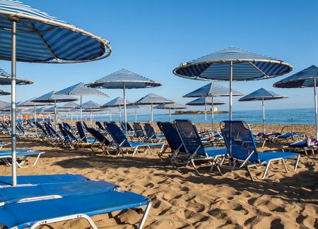 Sunbeds at the beach in Malia on Crete, Greece