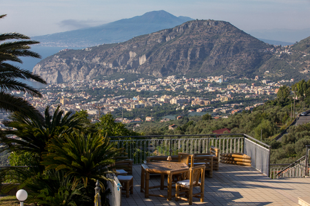 Armchairs and table on the terrace overlooking the Bay of Naples and  Vesuvius. Sorrento. Italy
