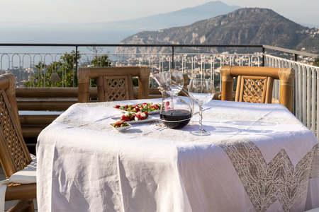 Prepared for supper table on the terrace overlooking the Bay of Naples and  Vesuvius. Sorrento. Italy