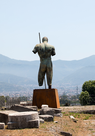 Pompeii, Italy: Sculptures of the Polish sculptor Igor Mitoraj on display at Pompeii archaeological site, the ancient Roman city, destroyed in 79 BC by the eruption of Mount Vesuvius.