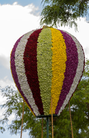 Funchal; Madeira; Portugal - April 22; 2018: Air balloon imitation made of colorful flowers  at Madeira Flower Festival Parade in Funchal . Madeira. Portugal.