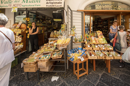 Amalfi, Italy - June 13, 2017: Limoncello liquor in a souvenir shop in Amalfi. Italy