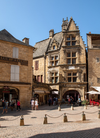 Sarlat, France - September 2, 2018: Historic houses surrounding Place du Peyrou in Sarlat la Caneda in Dordogne Department, Aquitaine, France Editorial