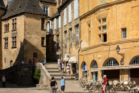 Sarlat, France - September 2, 2018: Historic houses surrounding Place de la Liberte in  Sarlat la Caneda in Dordogne Department, Aquitaine, France