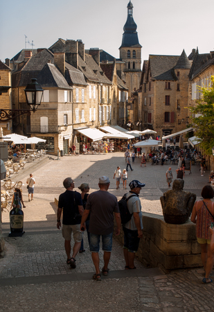 Sarlat, France - September 2, 2018: Historic houses surrounding Place de la Liberte in Sarlat la Caneda in Dordogne Department, Aquitaine, France Editorial