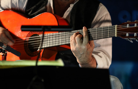 Close-up of a man's hands playing the classical guitar