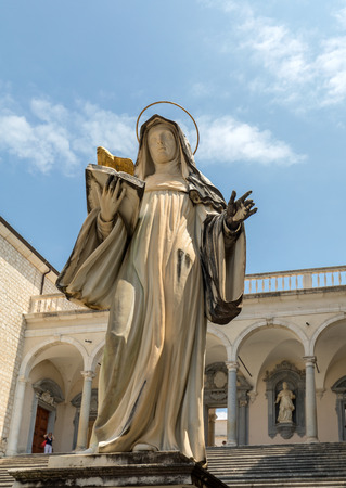 Montecassino, Italy - June 17, 2017: Marble statue of St. Scholastica by P. Campi of Carrara, in the Cloister of Bramante, Benedictine abbey of Montecassino. Italy Editorial