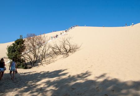 Dune of Pilat, France - September 10,2018:  People climbing the Dune du Pilat, Aquitaine, France Europe