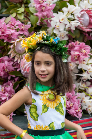 Funchal; Madeira; Portugal - April 22; 2018: Annual parade of the Madeira Flower Festival in the city of Funchal on the Island of Madeira. Portugal. Foto de archivo - 115285761