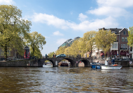 Amsterdam, Netherlands - April 20, 2017: Beautiful view of Amsterdam canals with bridge and typical dutch houses. Netherlands 에디토리얼