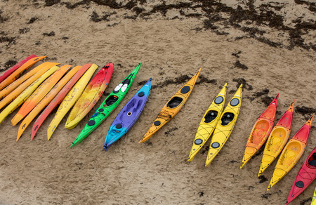 Colorful canoes on beach in Saint Malo, Brittany, France