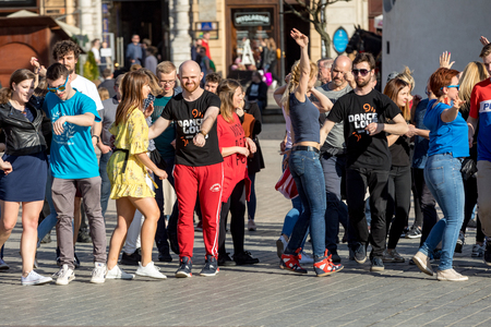 Cracow, Poland - Maerch 30, 2019:  International Flashmob Day of Rueda de Casino. Several hundred persons dance Hispanic rhythms on the Main Square in Cracow. Poland Editorial