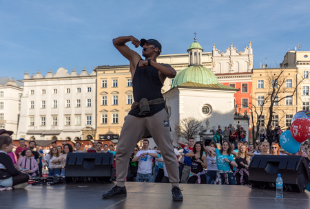 Cracow, Poland - Maerch 30, 2019:  International Flashmob Day of Rueda de Casino. Several hundred persons dance Hispanic rhythms on the Main Square in Cracow. Poland Sajtókép
