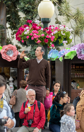 Funchal; Madeira; Portugal - April 19, 2018: Colorful decorations  over streets during the Madeira Flowers Festival in Funchal on Madeira Island. Portugal