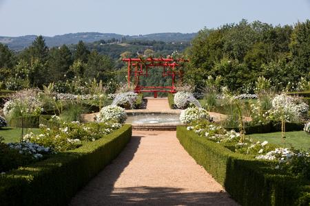 White garden in the picturesque Jardins du Manoir d Eyrignac in Dordogne. France