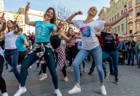 Cracow, Poland - March 30, 2019:  International Flashmob Day of Rueda de Casino. Several hundred persons dance Hispanic rhythms on the Main Square in Cracow. Poland Редакционное