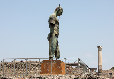 Pompeii, Italy - June 15, 2017: Sculptures of the Polish sculptor Igor Mitoraj on display at Pompeii archaeological site, the ancient Roman city, destroyed in 79 BC by the eruption of Mount Vesuvius.