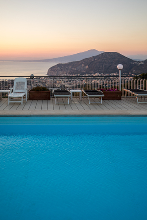 Swimming pool on the Amalfi Coast with views of the Gulf of Naples and Vesuvius. Sorrento. Italy Фото со стока