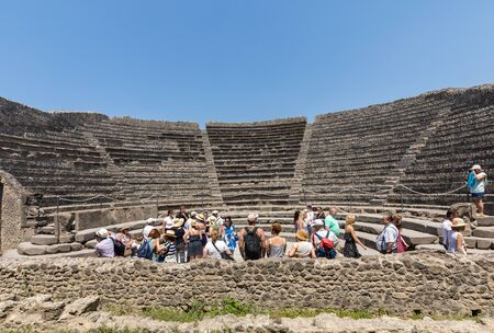 Pompeii, Italy - June 15, 2017:  The famous archaeological site of Pompeii heritage. Crowd of tourists under the scorching sun.