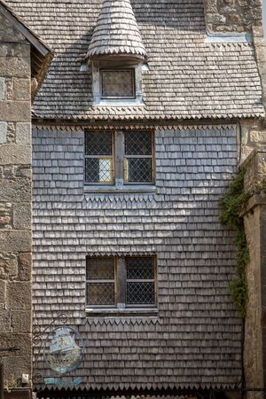 Le Mont-Saint-Michel, France - September 13, 2018: Ancient buildings of the old town on the famous Mont Saint Michel island in France