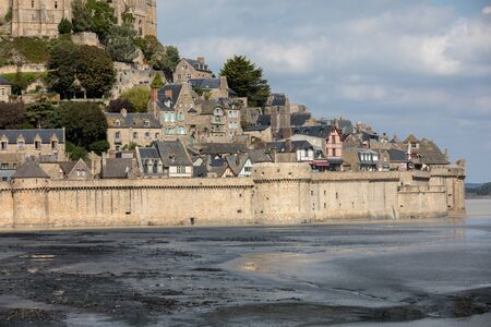Le Mont Saint-Michel, medieval fortified abbey and village on a tidal island in the Normandy, France, at low tide