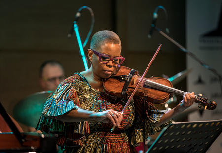 Cracow, Poland - March 9, 2019: Regina Carter, American jazz violinist an AMC Trio  live on stage of Manggha Museum of Japanese Art and Technology. Krakow. Poland Éditoriale
